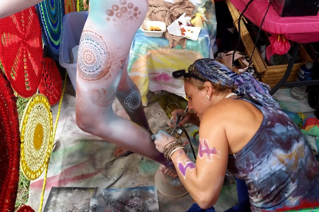 A competitor in the airbrush category of the Australian Body Art Festival 2019 painting her model.