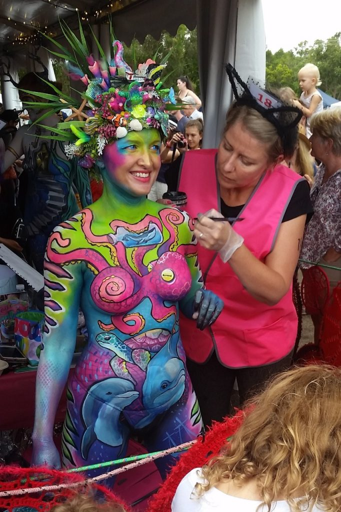 A competitor in the brush and sponge category of the Australian Body Art Festival 2019 painting her model.